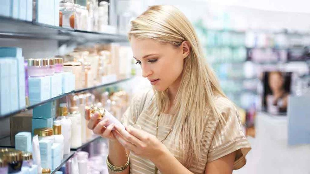 woman-in-a-shop-looking-at-cosmetics-label-1